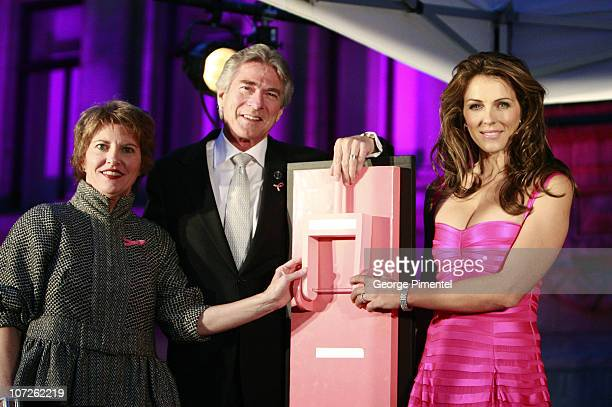 Kathleen Bartels Gary Balasky and Elizabeth Hurley flip a switch to illuminate the Vancouver Art Gallery in support with Estee Lauder for the Breast...