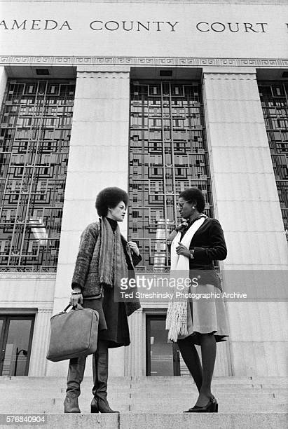 Kathleen Cleaver wife of the Black Panther leader Eldridge Cleaver stands on the steps of the courthouse talking with a friend during Eldridge's...