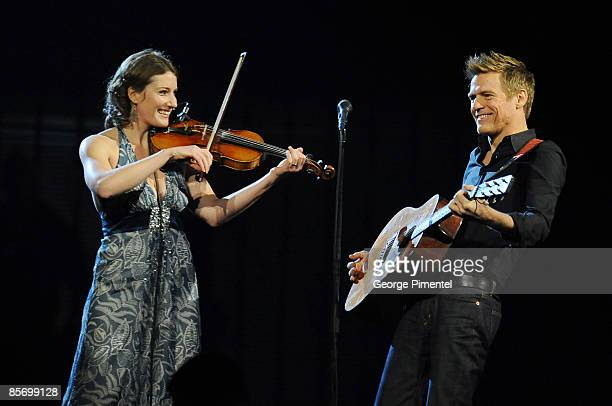 Kathleen Edwards and Bryan Adams perform during the 2009 Juno Awards at General Motors Place on March 29 2009 in Vancouver Canada