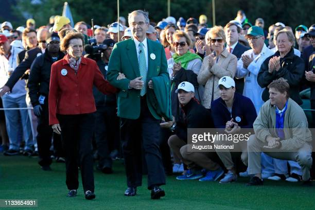 Kathleen Gawthrop wife of Masters champion Arnold Palmer is accompanied onto the No 1 tee by Chairman of Augusta National Golf Club and the Masters...