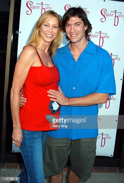 Kathleen Kinmont and Chris Brewster during Sugar Baby Kid's Boutique Store Opening at Sugar Baby in Los Angeles California United States