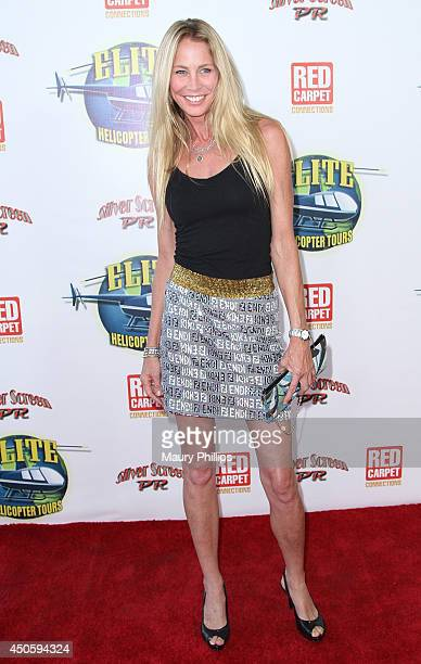 Kathleen Kinmont arrives at Lorenzo Lamas' New Business Elite Helicopter launch party at the Van Nuys Airport on June 13 2014 in Van Nuys California