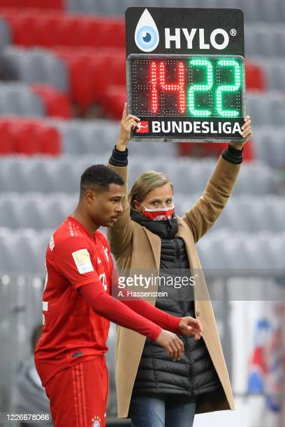 Kathleen Krüger, team managerin FC Bayern Muenchen holds the substitution board during the Bundesliga match between FC Bayern Muenchen and Eintracht...