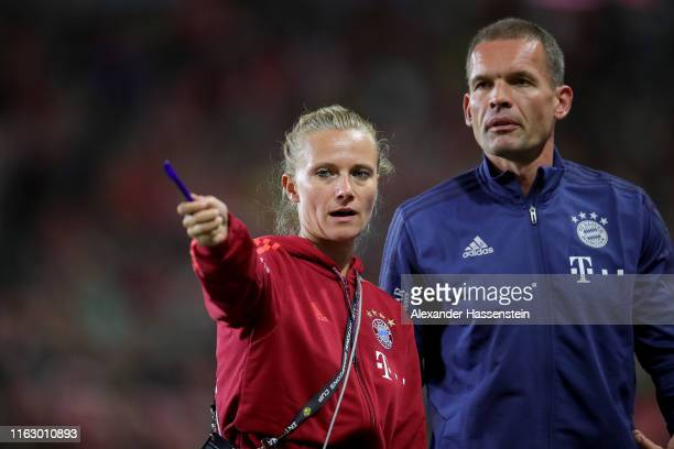 Kathleen Krueger, team manager of Bayern Muenchen talks to Holger Broich, fitness coach of Bayern Muenchen during the 2019 International Champions...