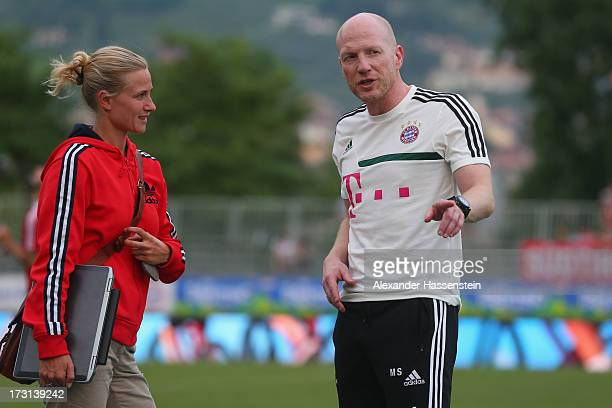 Kathleen Krueger, team manager of FC Bayern Muenchen looks on with Matthias Sammer, Sporting director of FC Bayern Muenchen during a training session...
