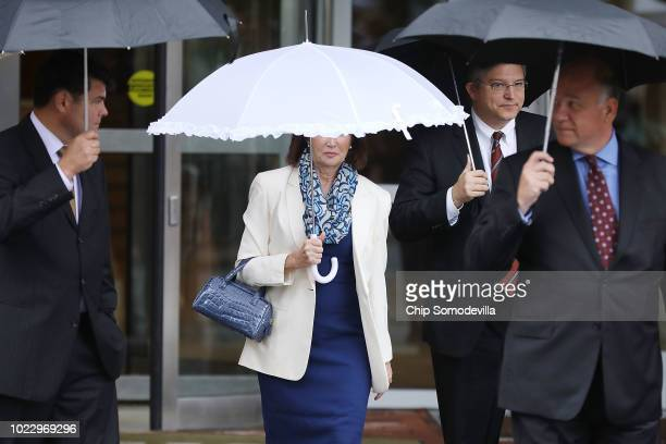 Kathleen Manafort wife of former Trump campaign chairman Paul Manafort and his attorneys Richard Westling and Thomas Zehnle walk back to the Albert V...