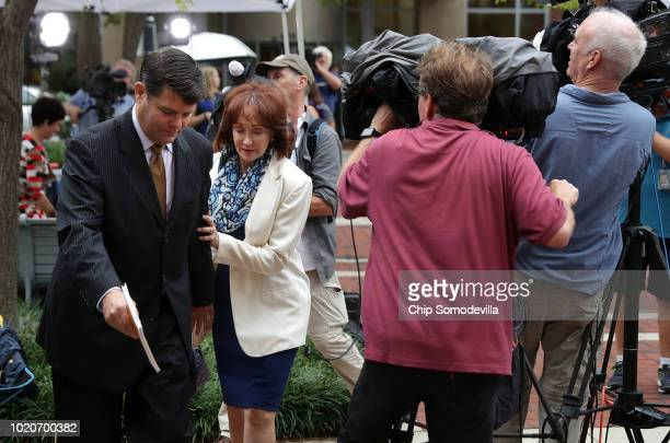Kathleen Manafort wife of former Trump campaign chairman Paul Manafort walks past television cameras as she arrives at the Albert V Bryan US...