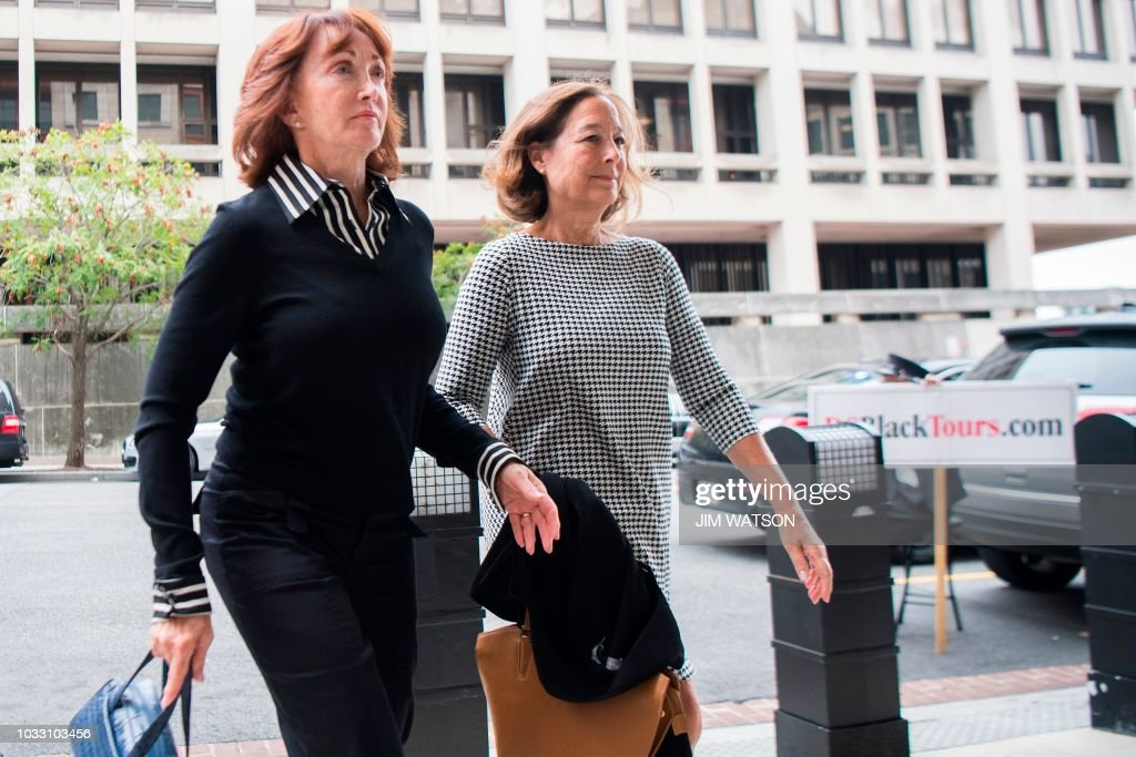 Kathleen Manafort (L), wife of former Trump campaign manager Paul Manafort arrives at the US Courthouse in Washington, DC, September 14, 2018. - Paul Manafort has agreed to plead guilty to charges of conspiracy to defraud the United States and witness tampering, court documents indicated. Seven charges in a previous indictment against Manafort were reduced to just two in a criminal information submitted to the court Friday by Special Counsel Robert Mueller, signaling a deal had been agreed with Manafort's lawyers to accept guilt.