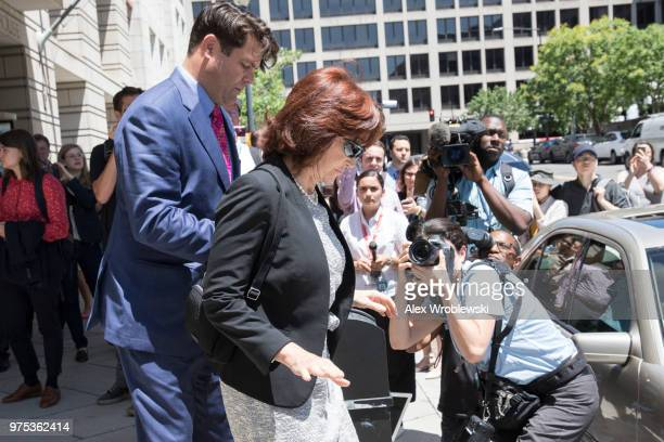 Kathleen Manafort wife to former Trump campaign manager Paul Manafort is helped to a waiting car after her husband's bail was revoked during a...