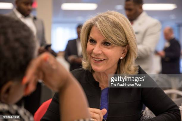 Kathleen Matthews who is running for Democratic Party chair talks with Jamila WoodsJones chair of the PG County Democratic Central Committee at the...