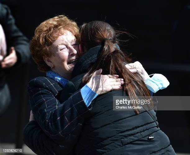 Kathleen McCarr, sister of Eddie Doherty is embraced by a family member after the findings of the Ballymurphy Inquest were revealed at the Waterfront...