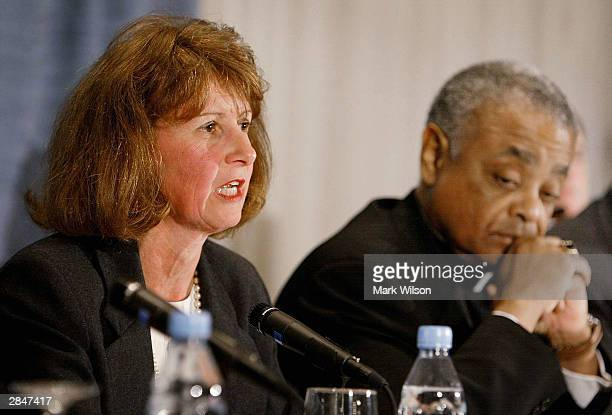 Kathleen McChesney head of the US Catholic bishops' watchdog Office of Child and Youth Protection and Bishop Wilton Gregory present an audit of 195...