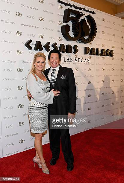 Kathleen McCrone and entertainer Wayne Newton arrive at Caesars Palace during the resort's 50th anniversary gala on August 6 2016 in Las Vegas Nevada