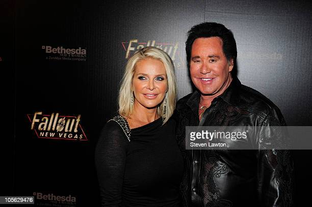 Kathleen McCrone and entertainer Wayne Newton arrive at the launch party for the video game 'Fallout New Vegas' at the Rain Nightclub inside the...