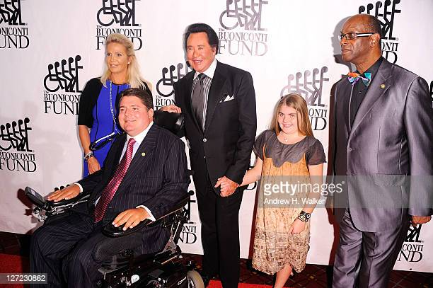Kathleen McCrone Marc Buoniconti and Wayne Newton and Bob Beamon attend the 26th Annual Great Sports Legends Dinner to benefit the Buoniconti Fund To...