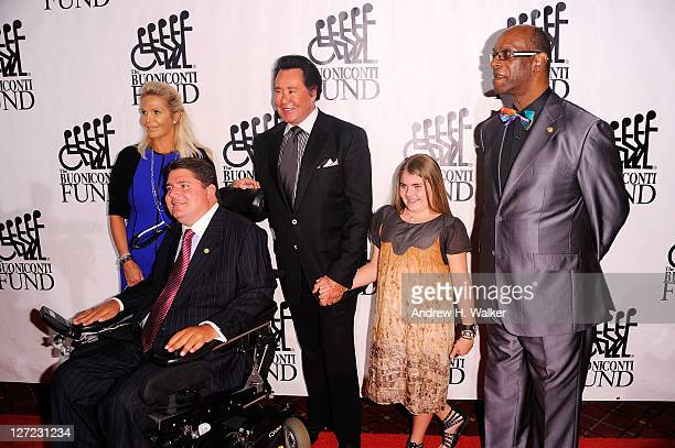Kathleen McCrone Marc Buoniconti Wayne Newton and Bob Beamon attend the 26th Annual Great Sports Legends Dinner to benefit the Buoniconti Fund To...