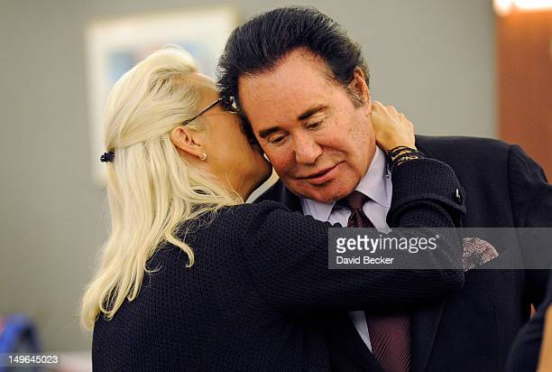 Kathleen McCrone Newton whispers to her husband entertainer Wayne Newton during a court recess at the Clark County Regional Justice Center on August...