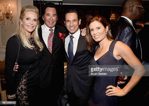 Kathleen McCrone Wayne Newton Helio Castroneves and Adriana Henao attend the 30th Annual Great Sports Legends Dinner to benefit The Buoniconti Fund...