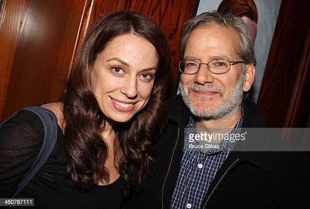 Kathleen McElfresh and husband Campbell Scott pose at the opening night party for Taking Care of Baby at Faces Names Lounge on November 19 2013 in...
