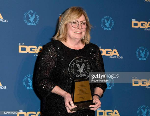 Kathleen McGill poses in the presroom with the Frank Capra Achievement Award during the 71st Annual Directors Guild Of America Awards at The Ray...