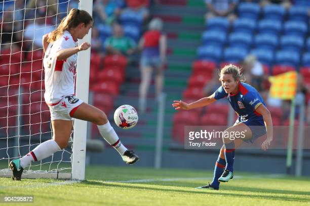 Kathleen Naughton of Adelaide stops a shot from Cassidy Davis of the Jets during the round 11 WLeague match between the Newcastle Jets and Adelaide...