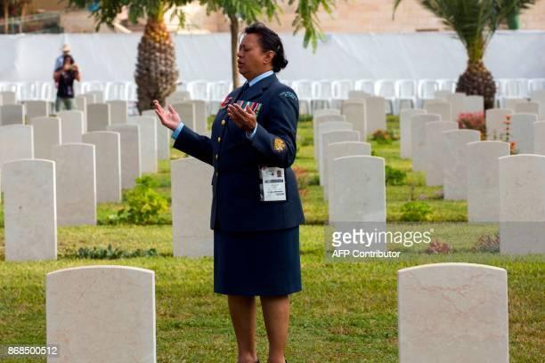 TOPSHOT Kathleen Niku a Mauri in New Zealand military uniform performs a prayer at the British Cemetery in Beersheba Israel on October 31 during a...