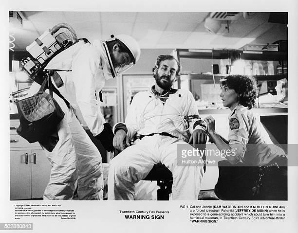 Kathleen Quinlan and Sam Waterston restrain Jeffrey DeMunn in a scene for the 20th Century Fox movie Warning Sign circa 1985