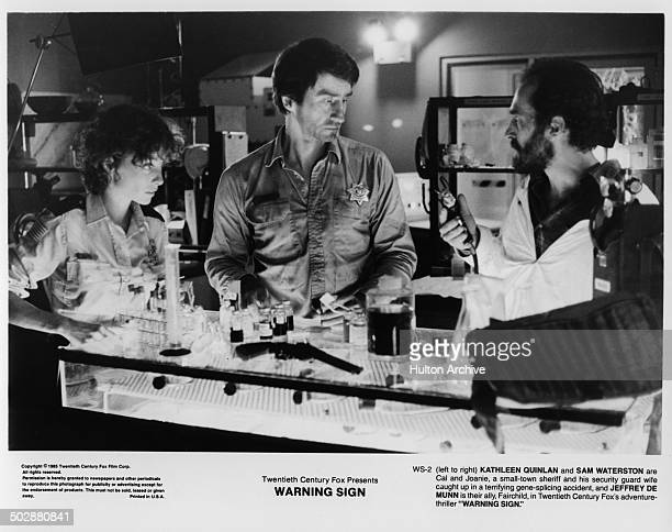 Kathleen Quinlan Sam Waterston and Jeffrey DeMunn stand in a gene splicing lab in a scene for the 20th Century Fox movie Warning Sign circa 1985