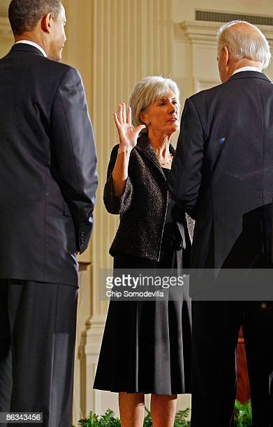 Kathleen Sebelius is sworn in as US Health and Human Services secretary by Vice President Joe Biden as President Barack Obama looks on during a...
