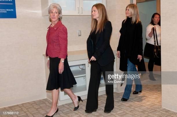 Kathleen Sebelius Kristin Hahn and Jennifer Aniston walk in during a visit to the Breast Care Center at the Inova Alexandria Hospital at Mark Center...