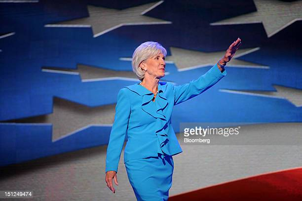 Kathleen Sebelius US health and human services secretary waves before speaking at the Democratic National Convention in Charlotte North Carolina US...