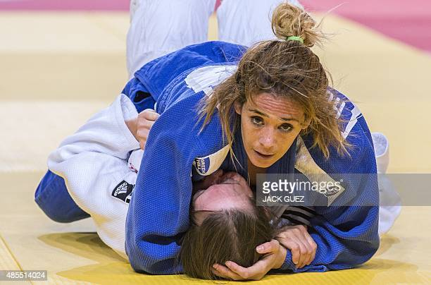 Kathleen Sell of US fights against Tunisia's Houda Miled during the womens qualification match in the 70kg category at the the IJF Judo World...