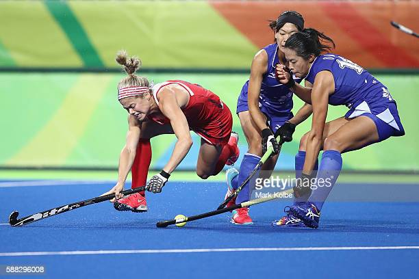 Kathleen Sharkey of the United States falls as she is tackled during the women's pool B match between the United States and Japan on Day 5 of the Rio...