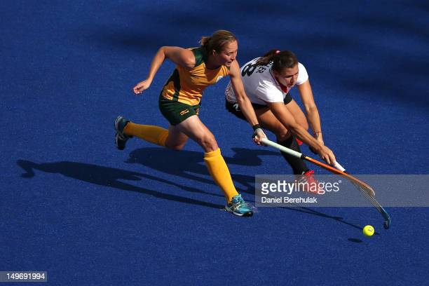 Kathleen Taylor of South Africa competes with Julia Mueller of Germany in the Women's Hockey preliminary match between South Africa and Germany on...
