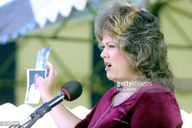 Kathleen Treanor who lost her mother and father in law as well as her daughter in the Oklahoma CIty bombing on 19 April 1995 shows pictures of her...