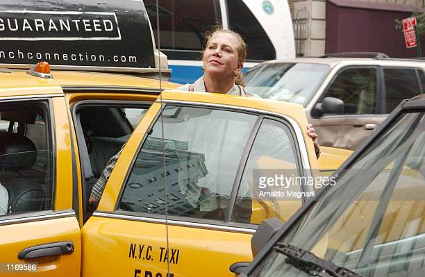 Kathleen Turner enters a taxi after having lunch at La Goulue restaurant October 14 2001 in New York City