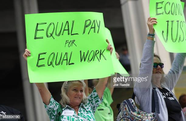 Kathleen Van Schalkwyk joins with other protesters to ask that woman be given the chance to have equal pay as their male coworkers on March 14 2017...