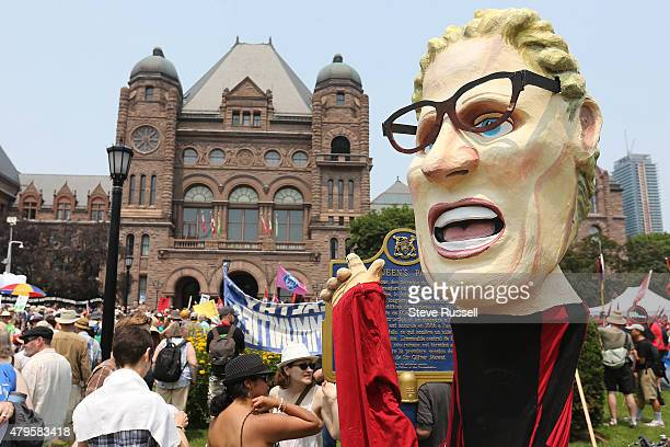 Kathleen Wynne puppet stands outside Queens Park Thousands participated in the March for Jobs Justice and Climate began at 1 pm at Queen's Park...