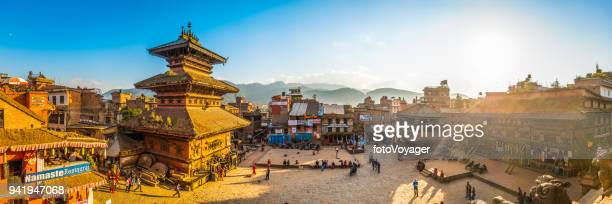 kathmandu ancient temples illuminated by golden sunset panorama bhaktapur nepal - nepal stock pictures, royalty-free photos & images