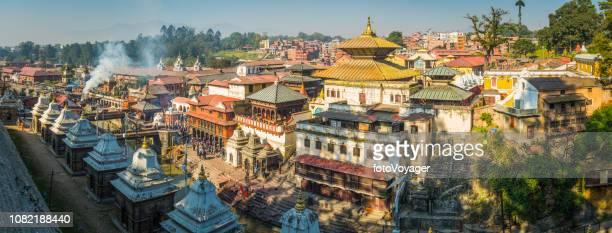 kathmandu bagmati ghats at pashupatinath temple shrines panorama nepal - kathmandu stock pictures, royalty-free photos & images