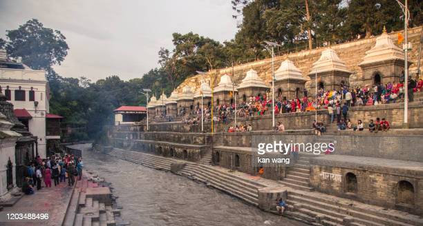 kathmandu bagmati ghats at pashupatinath temple shrines panorama nepal - stock photo - pokhara stock pictures, royalty-free photos & images
