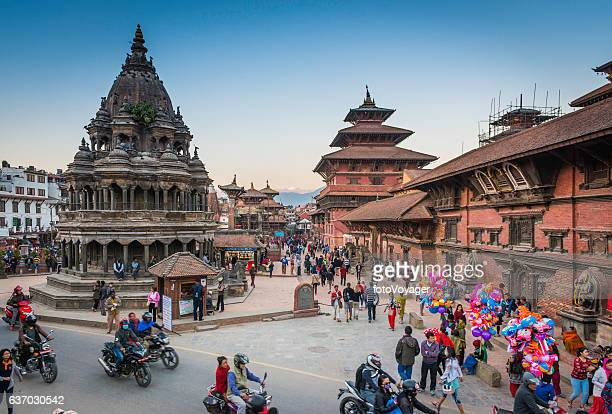 kathmandu crowds of people outside temples patan durbar square nepal - nepal stock pictures, royalty-free photos & images