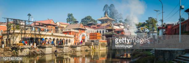 kathmandu ghats on bagmati river pashupatinath temples panorama nepal - pashupatinath stock pictures, royalty-free photos & images