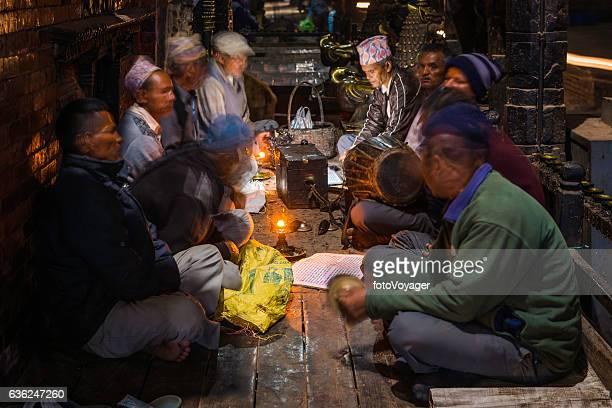 Kathmandu men singing traditional chants candlelight Durbar Square Bhaktapur Nepal