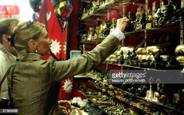A French tourist shops for decorative items at Thamel the famed tourist centre in Kathmandu 18 April 2006 Thamel is not the kind of place usually...