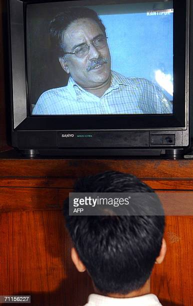 An office boy watches a television showing Chairman of the Nepalese Maoist rebel Pushpa Kamal Dahal popularly known as ''Prachanda'' for the first...