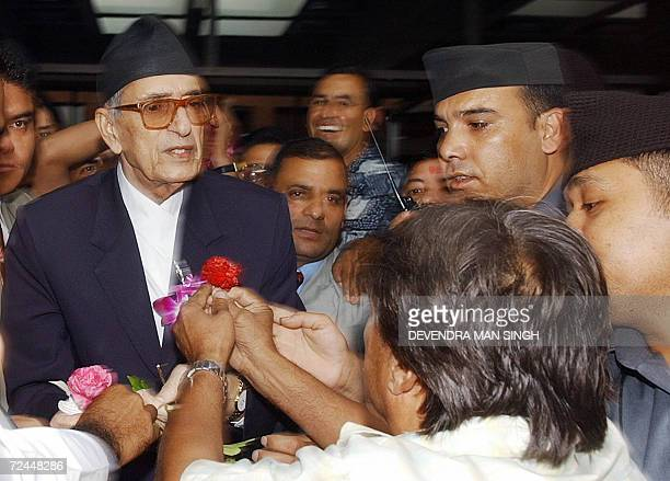 In this file photograph taken 27 June 2006 Nepalese Prime Minister Girija Prasad Koirala is welcomed by his party activists upon his arrival at The...