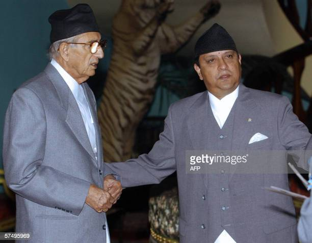 King Gyanendra of Nepal gestures towards newly sworn in Prime Minister Girija Prasad Koirla at a ceremony in Naryanhiti Royal Palace in Kathmandu 30...