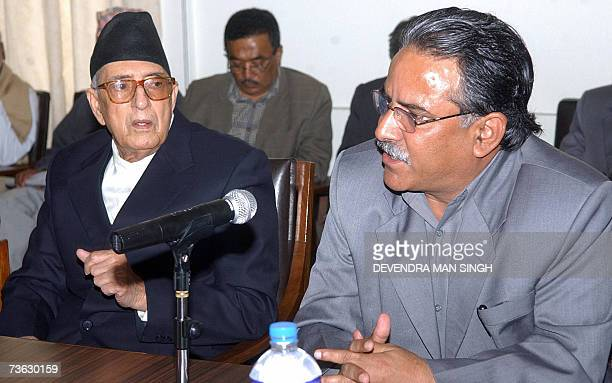 Maoist Chairman Prachanda is flanked by Nepalese Prime Minister Girija Prasad Koirala as he speaks during a meeting with the country's Chief Election...