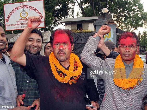 Nepalese Maoist leaders Suresh Ale Magar and Matrika Yadav raise their hands in salute after their release from Nakhu Jail in Kathmandu 11 May 2006...